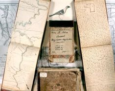 "Collage of Lewis  and Clark journals: in the background is the map of their trip; open journal on the left with river is ""draught of the fal..."
