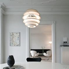 The Poulsen PH Snowball Pendant is a wonder not only of glare-free illumination, but also of precise mathematics I swan chair