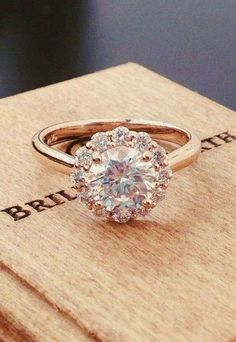 subtle floral diamond halo blooms around the center gem in this exquisite ring via brilliantearth / http://www.deerpearlflowers.com/rose-gold-engagement-rings/