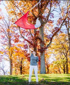 Senior photo ideas, only I'd change the color of the flag so that you could see it.