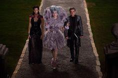 Peeta Mellark (Josh Hutcherson, left), Effie Trinket (Elizabeth Banks, center) and Katniss Everdeen (Jennifer Lawrence, right) in THE HUNGER GAMES: CATCHING FIRE.  Photo courtesy of Lionsgate