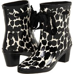Animal print rubber rain boots with heel and a bow. I would feel fabulous stomping in puddles with these.
