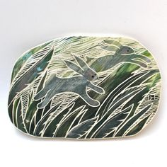 rabbits in tall grass hand carved ceramic art tile  LOVE THIS!