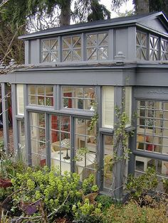 Designed by Randolph Scott Keller and constructed by Jennie Hammill, this miniature conservatory incorporates 43 recycled glass windows and doors