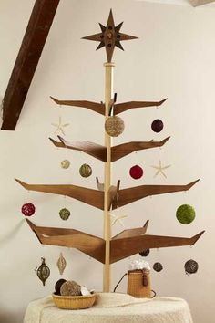 unconventional christmas trees | alternative-christmas-trees-carved-wood-2-use open books