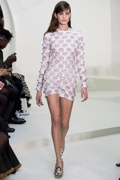 Christian Dior white with candy coated cut outs makes a simplistic silhouette new to any eye.