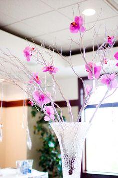 Purple flowers in tall vase