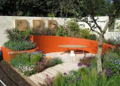 Orange curved wall- Chelsea Garden Show - colorful wall