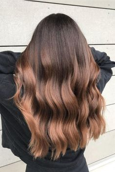Metallic Ombré | Cream soda? That's so yesterday. While it might seem as if hair color trends are a dime a dozen this season, we're not complaining. From rose brown to pearl blonde, we love seeing ladies switch up their locks like they switch up their nail polish. Now, a radiant hair trend for brunettes is resurging just in time for summer, and we're more than here for the low maintenance, multi-dimensional blend. Move aside, cream soda—root beer hair is giving all the soda-inspired tint we