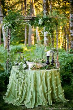(love the green) Arbor with table for outdoor wedding reception. Toned down with native flowers..