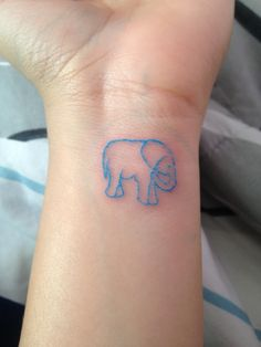 I want something like this on the back of my neck, but with his trunk up and music notes coming from it