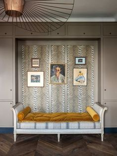 House tour: a 1930s Parisian-style apartment in Warsaw: 'La Panthere' fabric in velvet by PIERRE FREY lines the walls of this recessed seating area.
