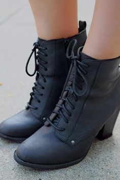 Complete the chic look with the She's Got It Bootie! These booties are versitile and will go with just about everything! These cuties feature a round toe, lace up front, a chunky stacked heel, and a s
