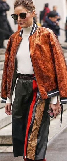 Who made Olivia Palermo's black sunglasses and bronze python print bomber jacket?