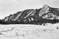 Fine Art black and white Boulder Colorado Winter landscape of the Flatirons. Fine art photography prints, decorative canvas prints, acrylic prints, metal Prints wall art  for sale on FineArtAmerica.com. Prints starting at $25. Copyright: James Bo Insogna