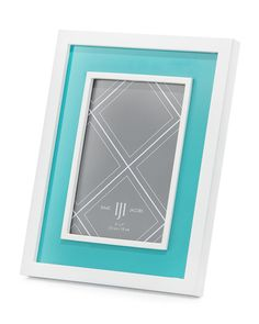 this turquoise lacquer frame from isaac jacobs features a turquoise center trimmed in white holds