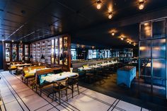 """Tim Raue's new brasserie, """"Colette"""", can be found directly opposite KaDeWe, near Berlin's busy boulevards of. Spice Trade, Oak Parquet Flooring, Bar Design Awards, Timber Panelling, Industrial Windows, Wall Cladding, Dark Wood, Coffee Shop, Dining Table"""
