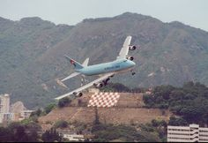 """Landing at the most dangerous runway 13 at Kai Tak Airport, the """"checkerboard hill"""" was used as a visual reference."""