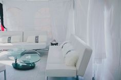 Rent our White Leather Sofas and coffee table for that elegant lounge look for your wedding or event