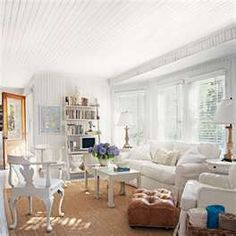White Walls, Sisal Rug.  Would also look good with brown leather sofa.  You could even make dropcloth slipcovers for sofa to use in summer, then take slipcovers off for darker look in fall/winter.