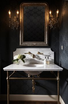 Ashley Goforth Design | Portfolio...powder room that is dark and glamorous with feminine flair. Great marble counter on console legs with custom backsplash, undermount sink, exposed ptrap to bring a little light into the room. White base moulding also brightens the room just a touch.