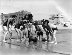 1931-Feeding Seal on Beach    A group feeding a seal on the beach in Long Beach, California.