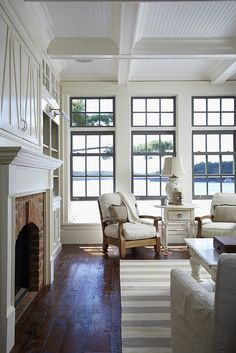 Living Room - I like the windows and brick around the fireplace (might be nice to match those with brick sidewalk out front? TV above fireplace?