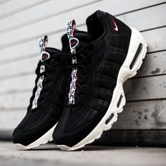 """Nike spoils us with a very special three-pack of the Air Max 95. Sporting unique pull tabs with black & blue """"N"""" logos, this beauty drops in a black, red and sail colorway. All three pairs of the beloved running sihouette are now available on KICKZ.com!"""