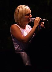 Sia in concert in 2006 In 2003, Furler released the EP Don't Bring Me Down, its lead track was used over the closing titles of the French film, 36 Quai des Orfèvres. Her third album, Colour the Small One, was released in Australia on 19 January 2004 and in Europe later that year.
