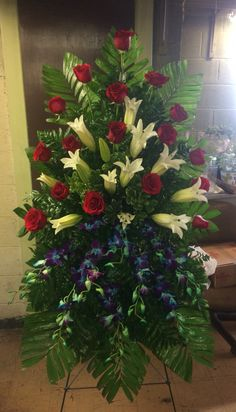 Red roses, Casablanca lilies, and blue orchids! Serving Wichita Falls, Texas for over 50 years! Funeral Floral Arrangements, Tropical Flower Arrangements, Creative Flower Arrangements, Church Flower Arrangements, Church Flowers, Beautiful Flower Arrangements, Funeral Flowers, Beautiful Flowers, Wedding Flowers
