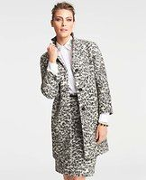 """Animal Jacquard Coat - Crafted in a wildly luxe wool blend, or irresistible animal jacquard topper adds undeniably chic allure to any ensemble. Notched lapel. 3/4 sleeves. Button front. On-seam welt pockets. Lined. 36"""" long. ANNTAYLOR.COM"""