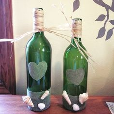 Sea Glass and Sand Beach Themed Wine Bottle with Raffia Wrap by JanellsCraftyKitchen on Etsy https://www.etsy.com/listing/251201525/sea-glass-and-sand-beach-themed-wine