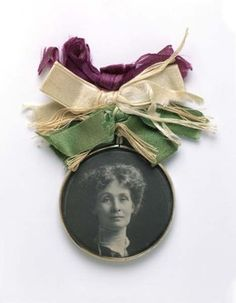 Glass-fronted medallion, containing portrait of Mrs Pankhurst and suspended from bunch of mauve, white and green ribbon