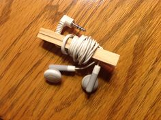 Clip the end of the headphone cord in the clothespin, wrap the cord around the pin, and drape the ear buds through the pincher end. Keeps headphones from getting tangled, easy to store and transport.