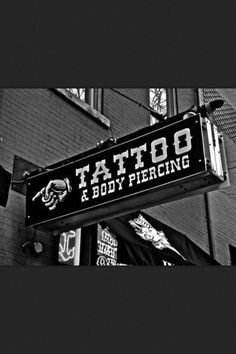 Hand painted tattoo sign government street tattoo studio for Street sign tattoos