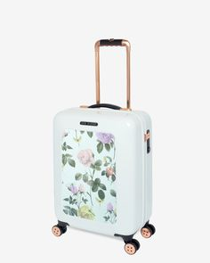 Ted Baker DEVI Small distinguishing rose suitcase £199  Ted Baker Luggage collection Distinguishing rose print Made from lightweight and robust makrolon polycarbonate 4 smooth-glide spinner wheels 5 year warranty TSA approved combination lock Rose gold tone detailing and scripted Ted Baker branding Weight: 2.55 kg Dimensions: 54 x 37 x 24cm Fabric Content: Outer: 100% Polycarbonate; Lining: 100% Polyester Care information: Wipe with a damp cloth