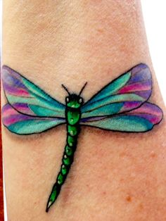 Beautiful dragonfly tattoo. Lovethe colour and has some 3D shadowing to it.