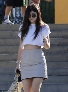 Kylie Jenner donned a nude leather mini-skirt on Saturday to hang at her home away from home - the Commons in Calabasas, California