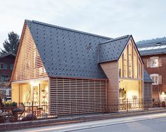 the shed-like appearance is emphasised by the steeply-pitched roof, while inside a showroom layout has been applied to invoke a sense of being at home.