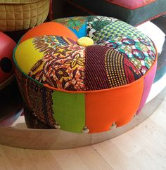 Sit on this An Afrotechnicolour Footstool par RayClarkeUpholstery, £160.00