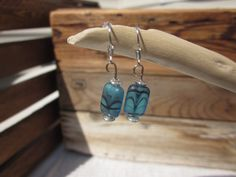 Blue glass earrings with black waves. $12.00, via Etsy.