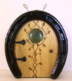 Wooden Hobbit / Fairy door made from recycled horseshoe with copper wire and burnt accents.
