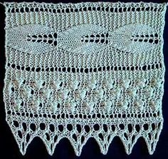 Wdie knitted lace with embossed leaf and bobble pattern