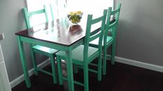 INGO dining table with dark stain and bright color