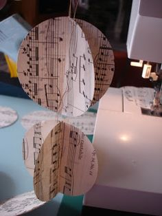 Creative Passage: Sheet Music Garland wouldn't have the heart to do this to actual sheet music but I would do copies!!