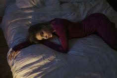 Lounging in bed, Barbara Palvin models body-hugging Givenchy dress