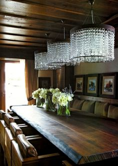 banquette on one wall, trestle table with chairs on opposite side. Nice change up with chandelier to relieve all the dark finishes