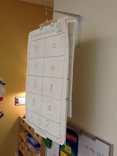 This Kindergarten teacher used a $1.18 L bracket (available at Lowe's Hardware) to store anchor charts.