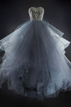 A full tulle skirt in deep gray compliments the shimmering sweetheart  bodice of...
