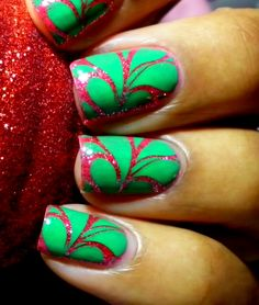 """""""The design was done using the new Red Angel Amazon plates. RA-107 to be exact! Base color is Essie Splash of Grenadine topped with China Glaze Mrs. Claus. Stamped with Konad franken (Konad Green + Konad Mint Green)"""""""